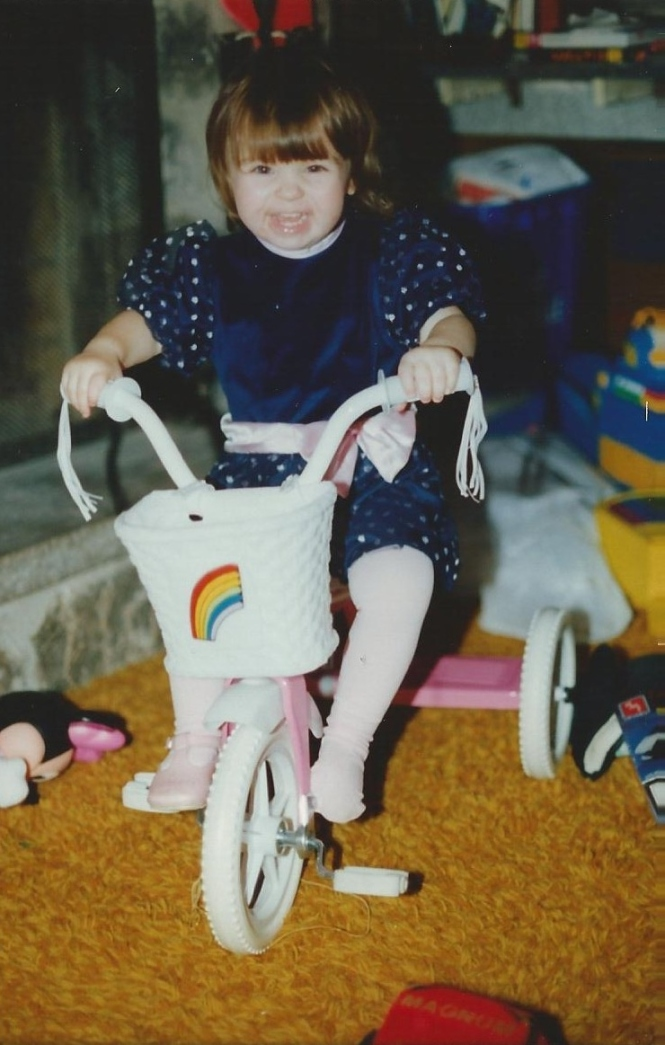 HADDEN Jenna at Christmas on trike 1991